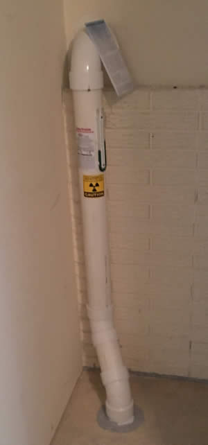 SRE HomeServices Radon Mitigation System In The Basement